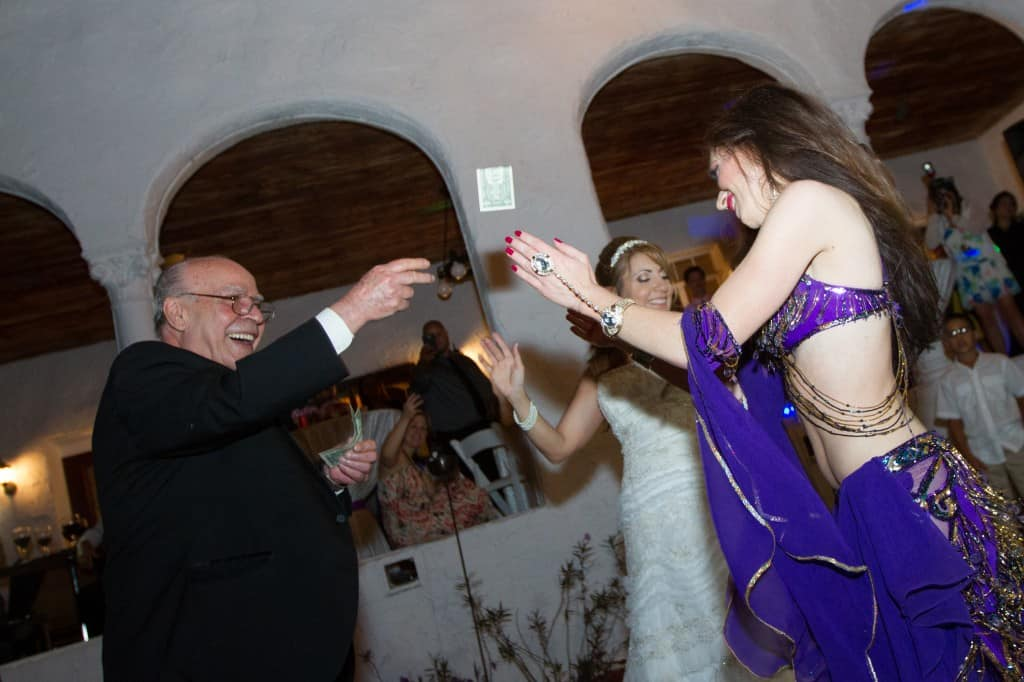 Orlando Belly Dancer Carrara Nour performs at an Armenian and Puerto Rican wedding at Estate of Johns Lake in Oakland, Florida. Photo: Scott Trippler Studios