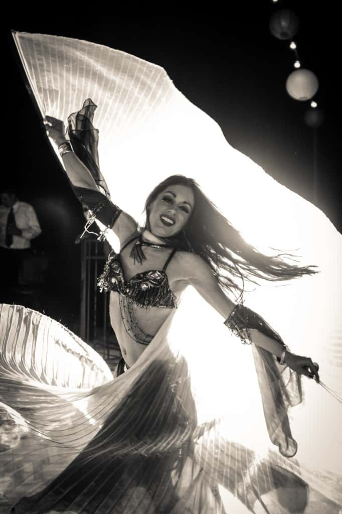 Belly Dancer Carrara Nour of Orlando performs with Isis wings at a Puerto Rican and Armenian wedding at Estate of Johns Lake in Oakland, Florida. Photo: Scott Trippler Studios