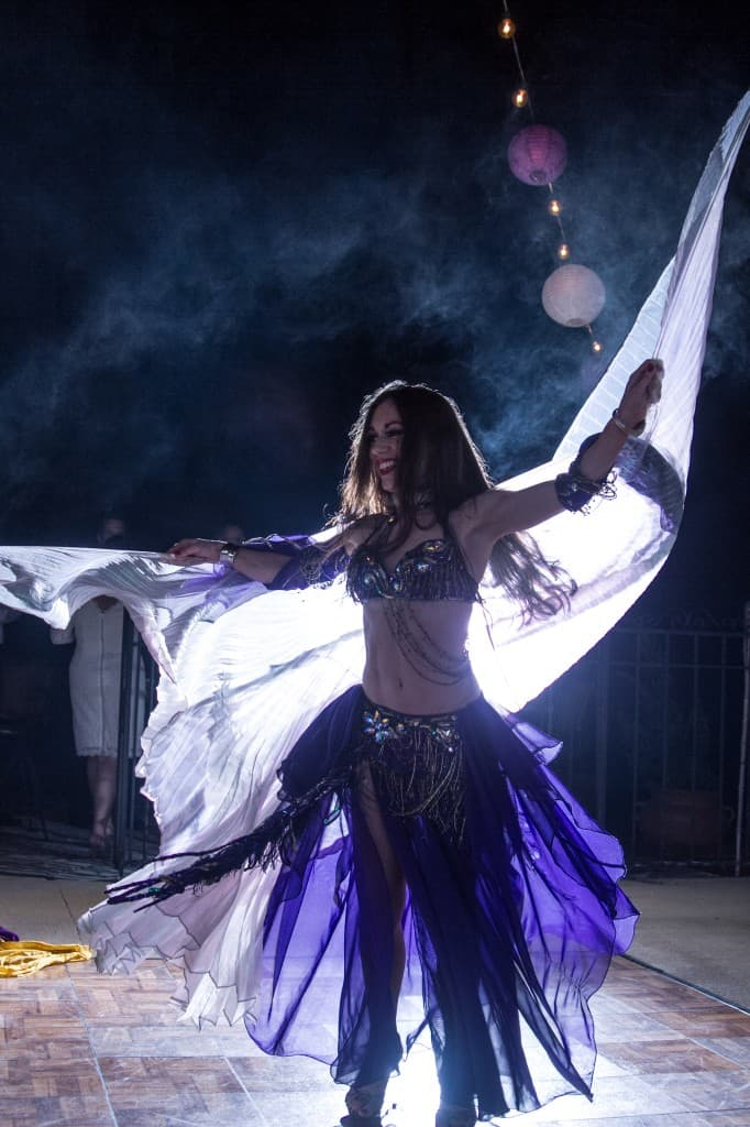 Belly Dancer Carrara Nour performs with Isis wings at an Armenian and Puerto Rican wedding at Estate of Johns Lake in Oakland, Florida. Photo: Scott Trippler Studios