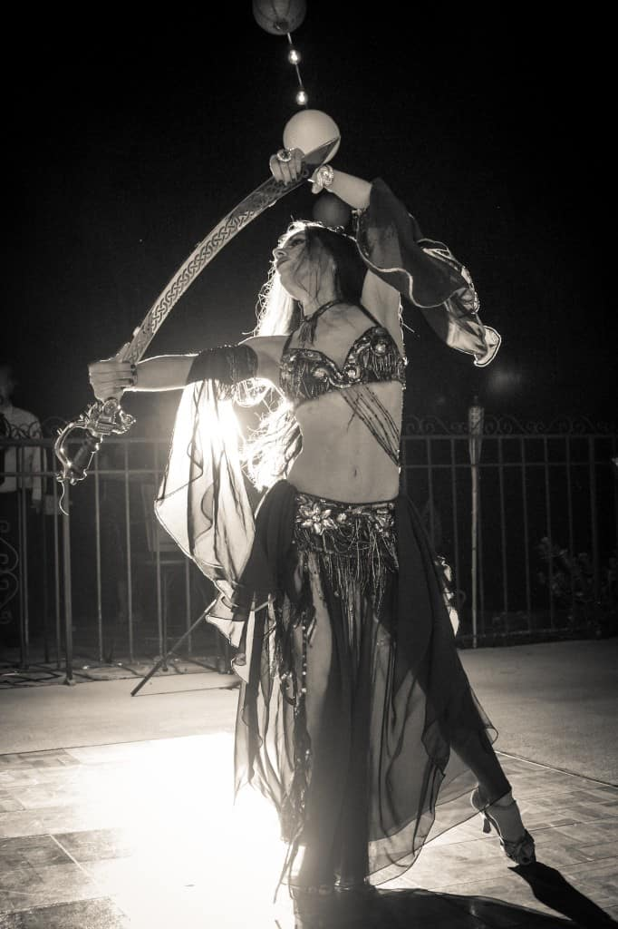 Belly Dancer Carrara Nour performs with a sword at an Armenian and Puerto Rican wedding at Estate of Johns Lake in Oakland, Florida. Photo: Scott Trippler Studios