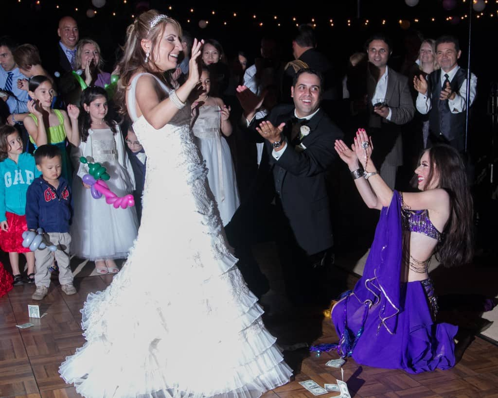 Belly Dancer Carrara Nour performs at an Armenian and Puerto Rican wedding at Estate of Johns Lake in Oakland, Florida. Photo: Scott Trippler Studios