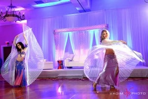 Carrara performs belly dance with Vanja at an Indian wedding in Tampa