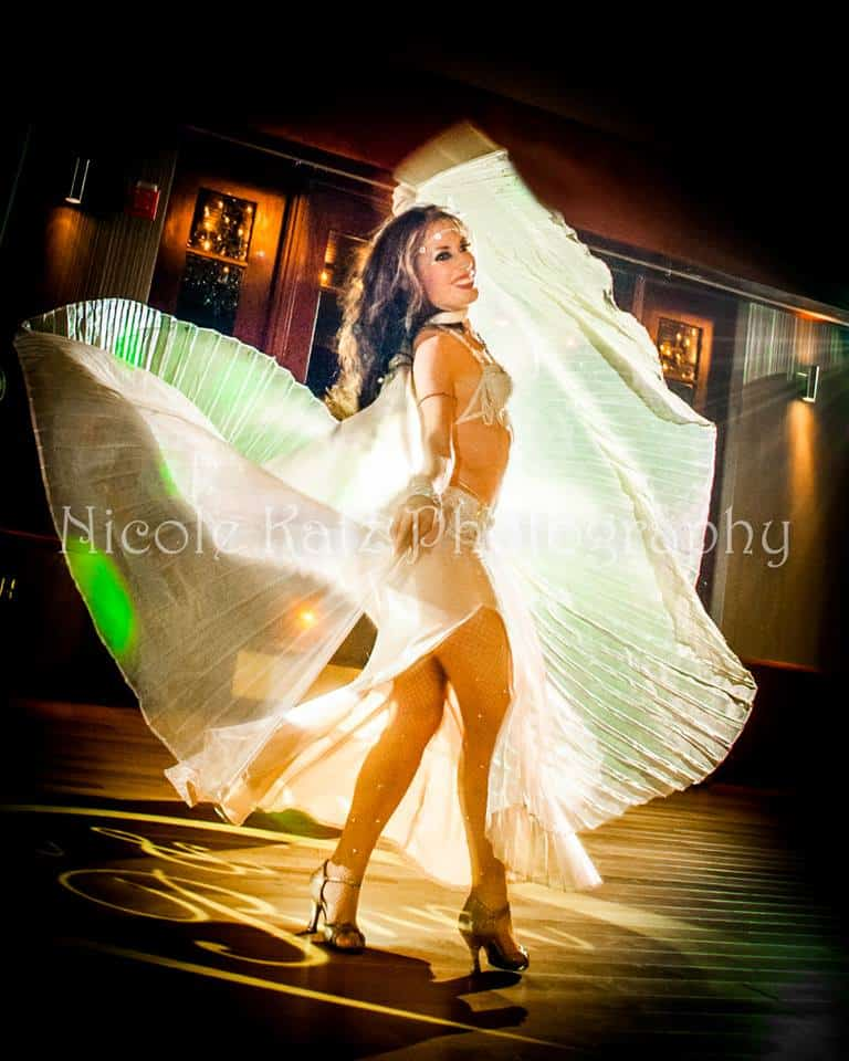 Carrara Nour, wedding belly dancer in Orlando, dances with isis Wings at a Lake Mary wedding reception