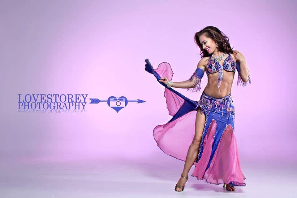 Orlando belly dancer Carrara Nour models in a photo shoot with wedding photographer Mandy Austin of LoveStorey Photography, with low-level fog (dancing on a cloud) by Rhythm of the Night Entertainment, and Digital Tiger Studios in Orlando