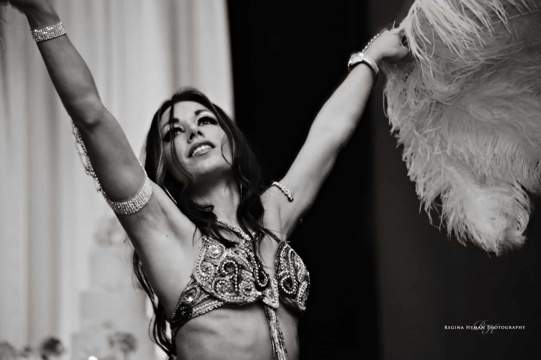 Belly Dancer Carrara Nour performs with feather fans at a wedding at the Ballroom at Church Street in Orlando