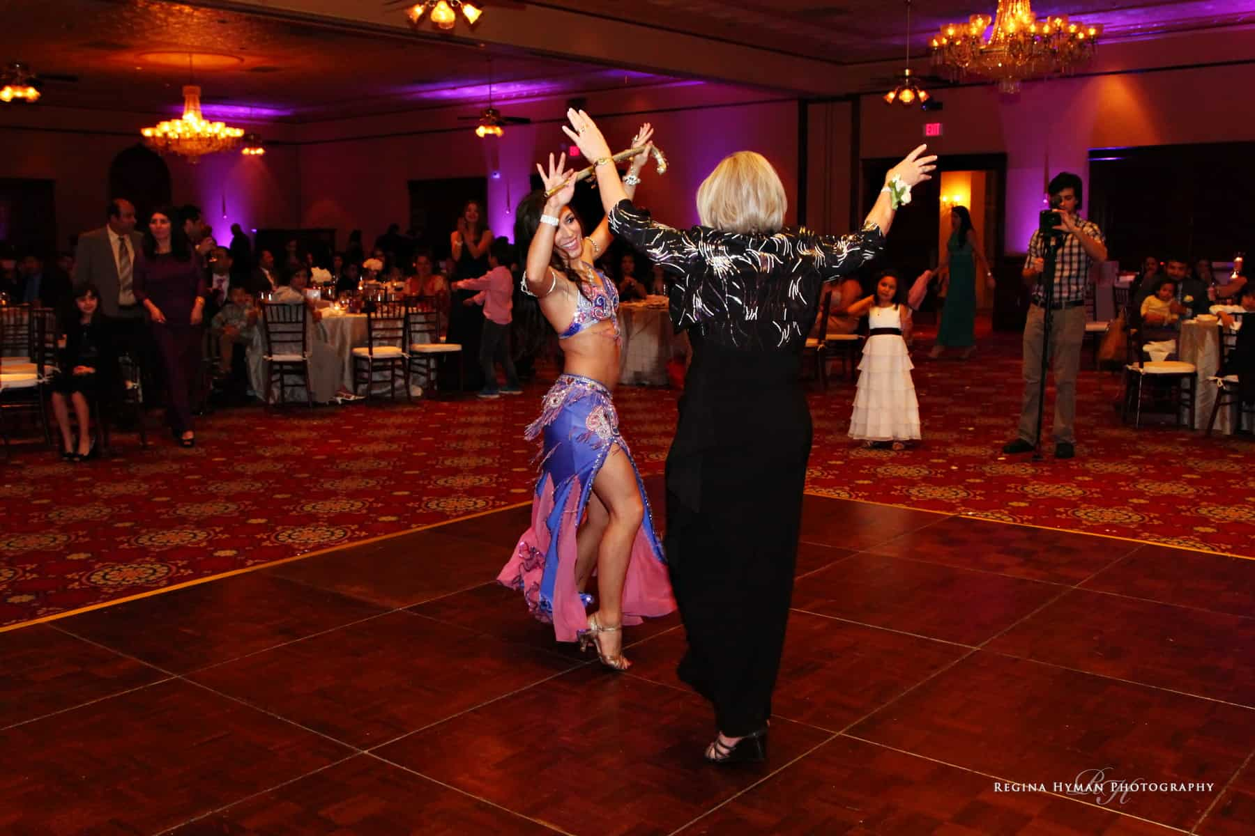 Orlando wedding belly dancer Carrara Nour performs an Egyptian cane dance at the Ballroom at Church Street in Orlando