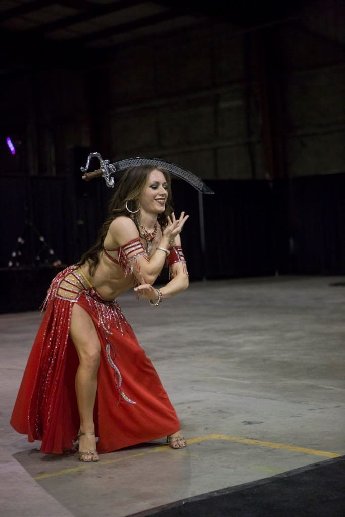Belly dancer Carrara Nour performs with a sword at an Orlando corporate event