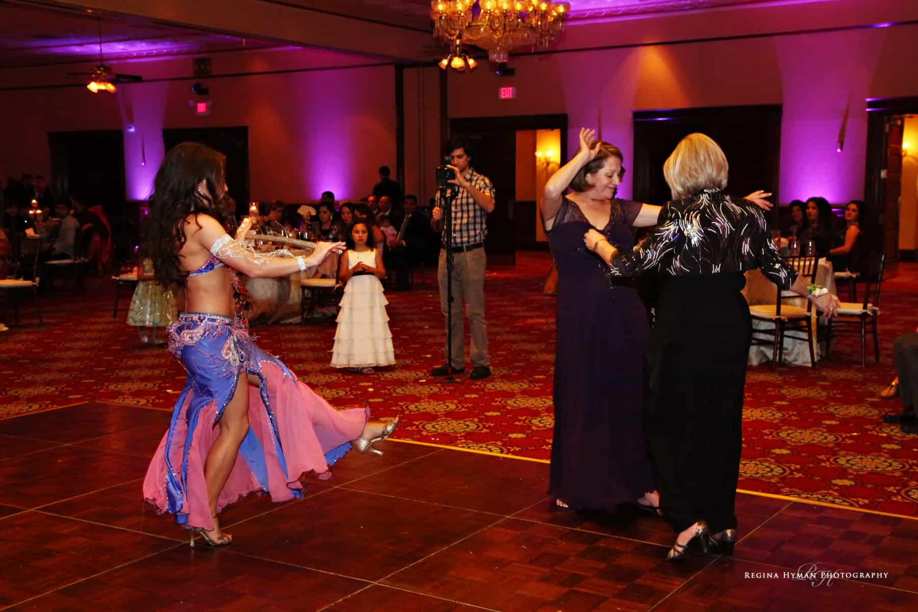 Belly Dancer Carrara Nour performs a cane dance at an Arabic Wedding in Florida