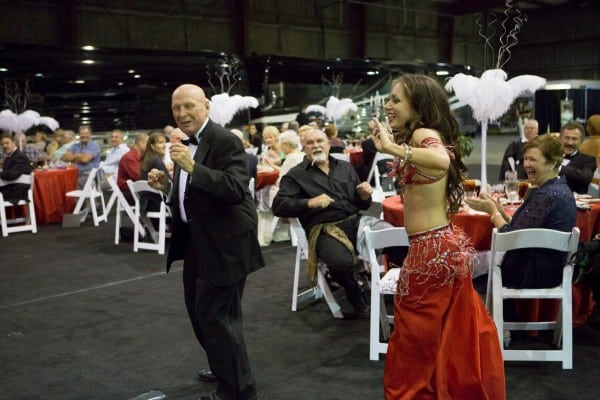 Belly dancer Carrara Nour teaches guests some new moves at a corporate event in Orlando