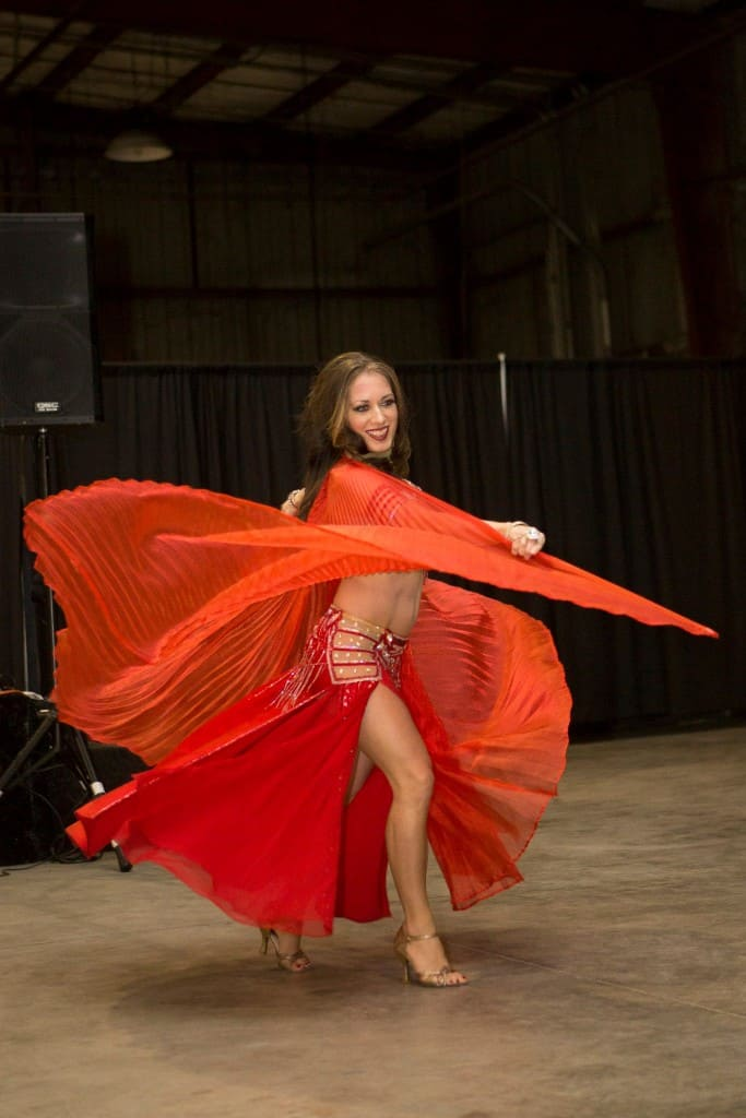 Carrara Nour performs with Isis wings at a corporate party in Orlando, FL
