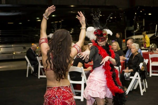 Carrara Nour, a belly dancer in Orlando, hams it up with a party guest