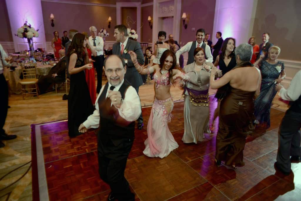 Belly dancer Carrara Nour of Orlando, FL gets the crowd to dance at a Turkish-American wedding