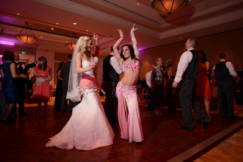 Carrara Nour, a belly dancer in Orlando, dances with the bride at a wedding at JW Marriott Grande Lakes, Orlando, FL