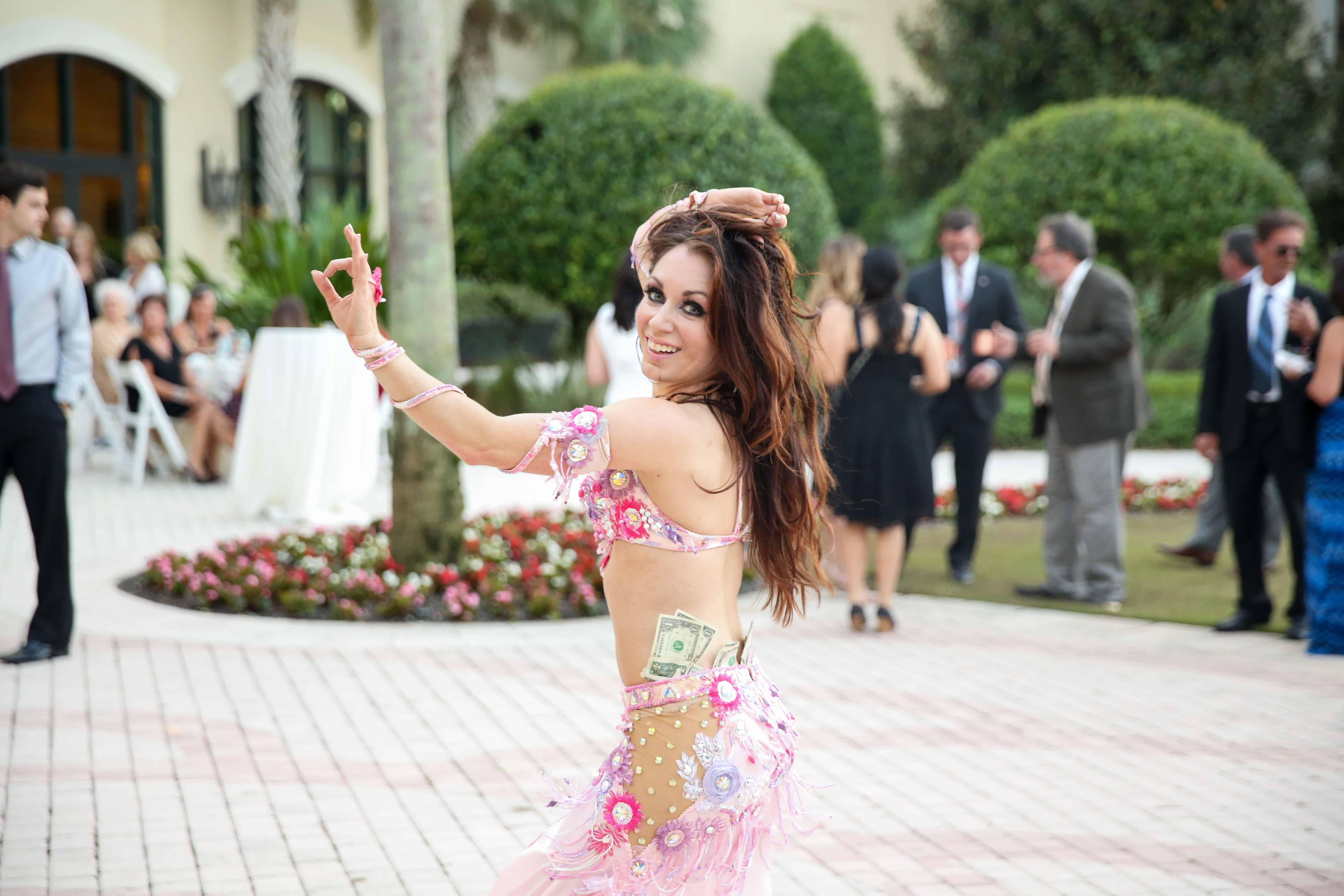 Carrara performs belly dance during the cocktail hour at an LGBT wedding at Omni Championsgate. Photo by LiveHappy Studio