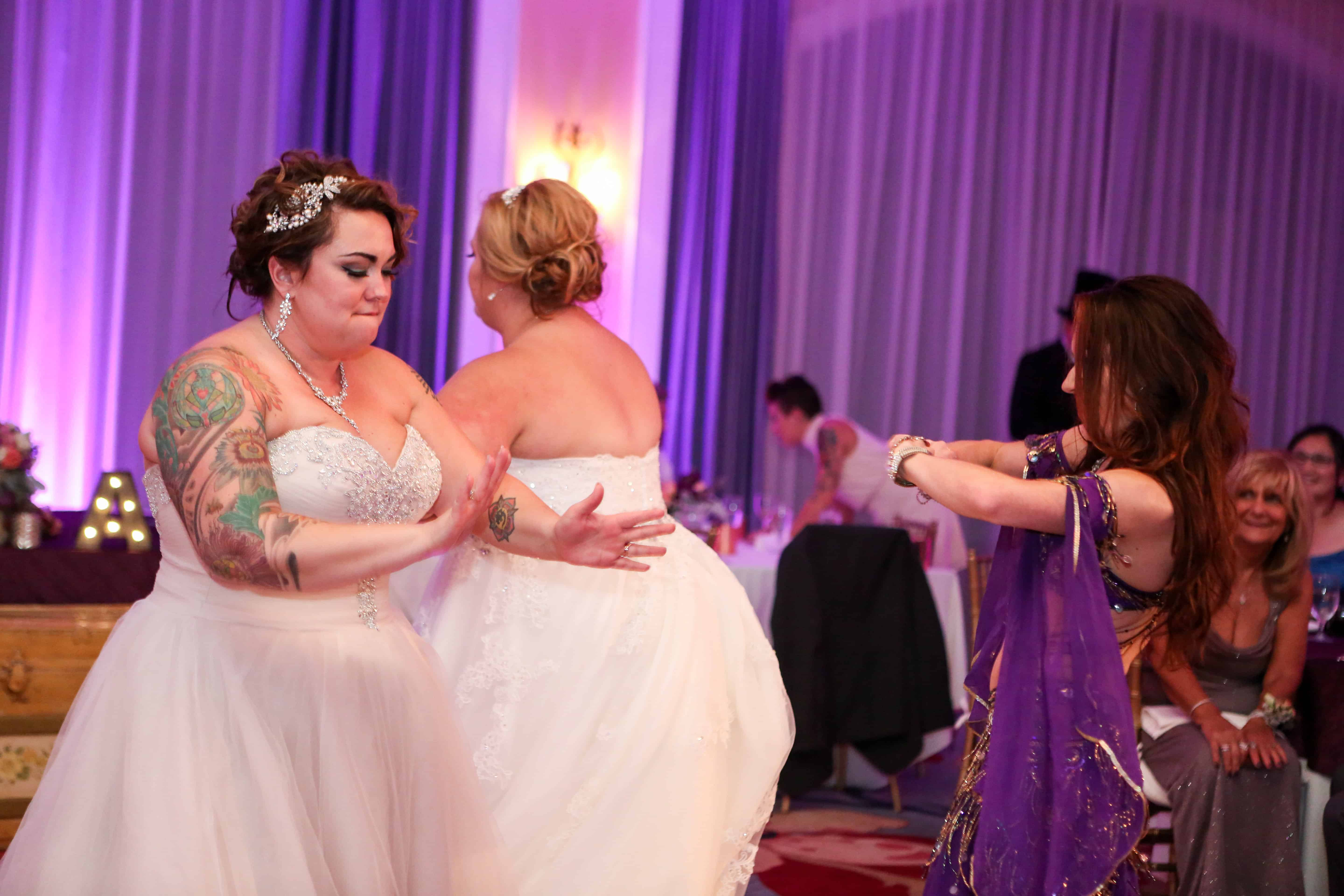 Carrara performs belly dance at an LGBT wedding at Omni Championsgate. Photo by LiveHappy Studio
