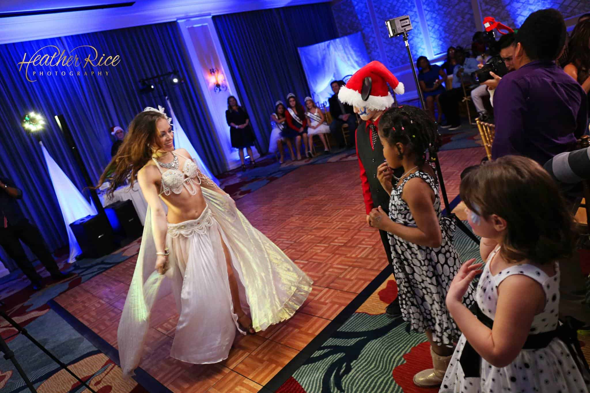 Orlando belly dancer Carrara Nour performs a Christmas-themed show at a party for Heart Gallery Winter Wonderland Gala at Omni Championsgate Resort. Photo by Heather Rice