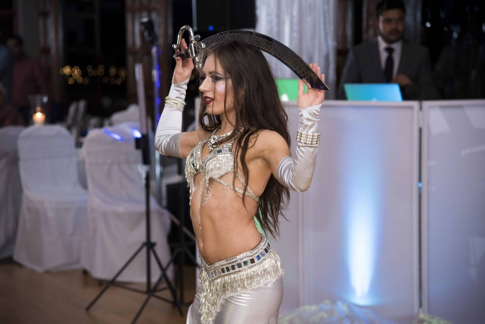 Carrara Nour (professional belly dancer for hire in Orlando) performs belly dance with a sword at an Indian anniversary party