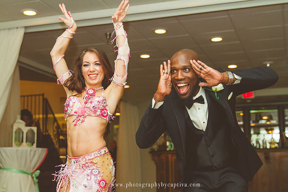 Carrara Nour performs belly dance at a Haitian wedding at Crystal Ballroom on the Lake, Altamonte Springs, FL. Photo: Photography by Captiva