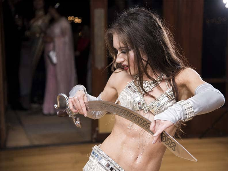 Orlando belly dancer Carrara Nour performs a sword dance at Timacuan Country Club Lake Mary FL
